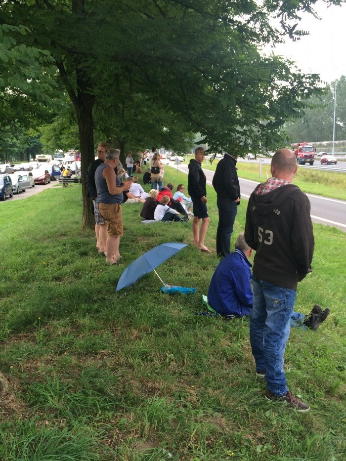 Some of the hundreds of people who gathered at the Ooijendonk rest area on the A2 near Boxtel