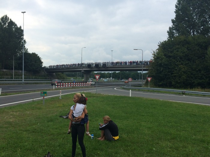 Crowd gathering on the A2 overpass, just north of the Ooijendonk rest area near Boxtel, waiting for the motorcade carrying the remains of victims of MH17.